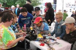 Sue teaching sewing bookmarks to boys in Prague