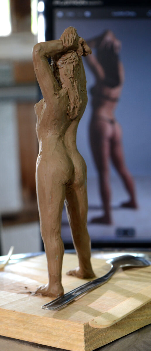 female figure sculpture practice with reference photo